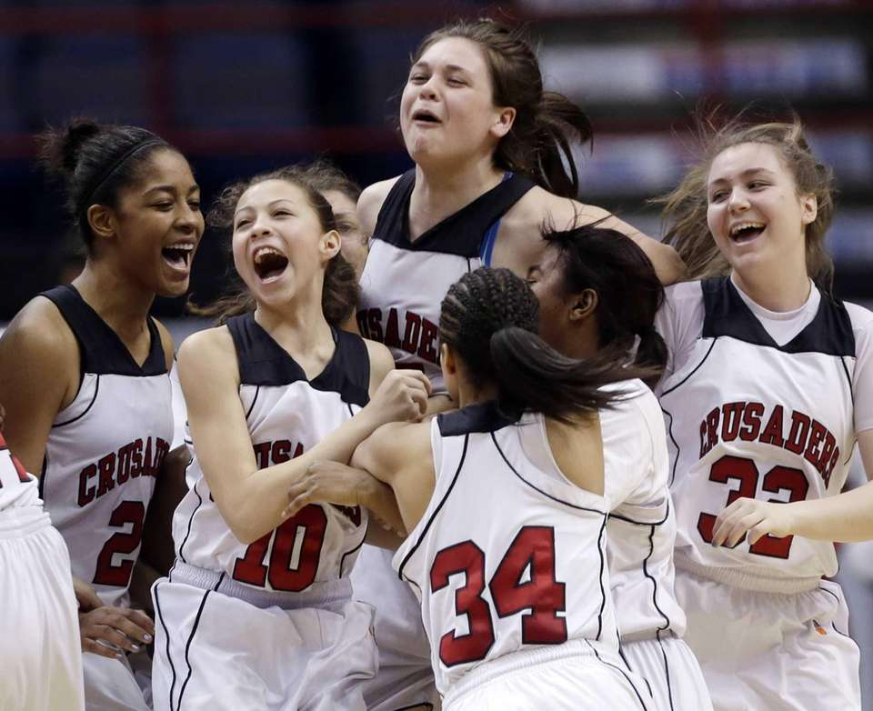 Long Island Lutheran players react after their 62-45