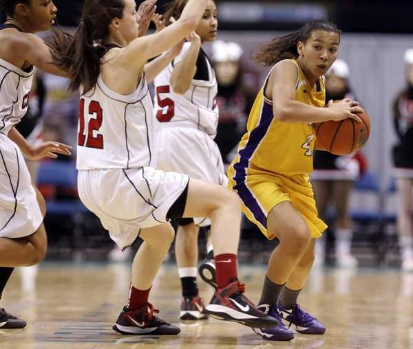 Troy's Kiana Patterson (4) looks to pass in