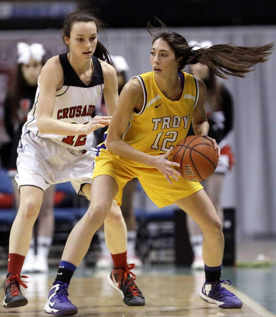 Troy's Courtney Avery, right, looks to pass in