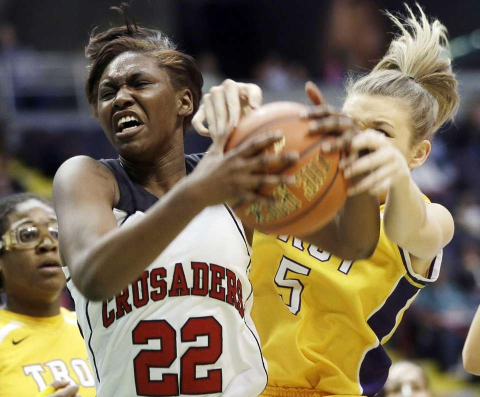 Long Island Lutheran's Staci Barrett (22) grabs a