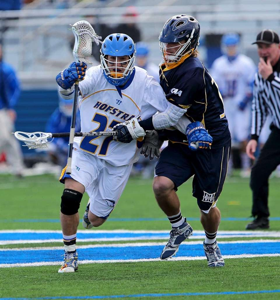 Hofstra's John Antoniades avoids the check of Drexel's