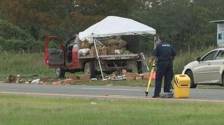 The scene on County Road 111 Monday after