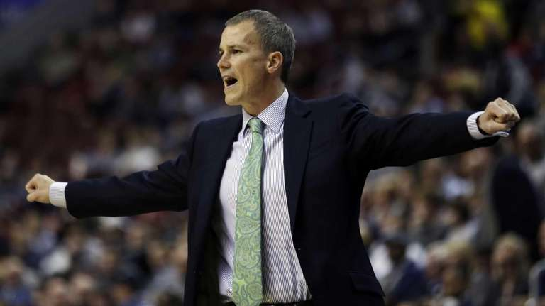 Florida Gulf Coast head coach Andy Enfield reacts