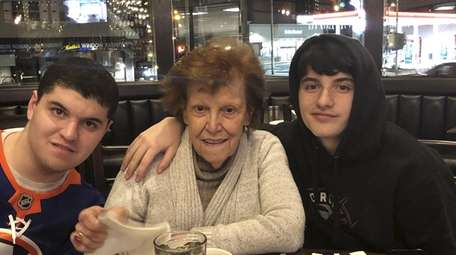 Josephine Bonfiglio with her grandsons, Jack Corbett, left,