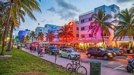 People enjoy Palm trees and art deco hotels