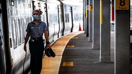 A Long Island Rail Road worker, with a