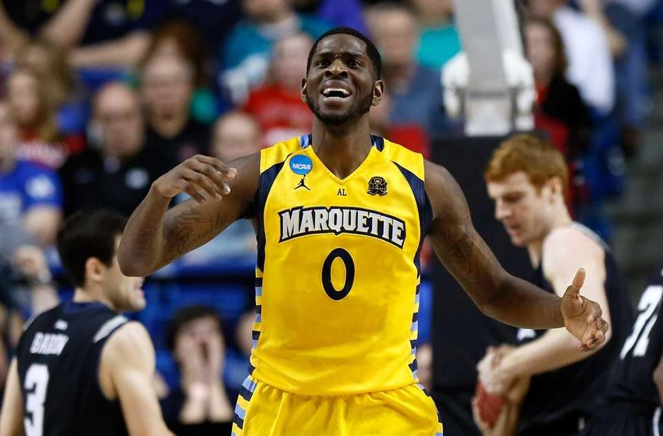Jamil Wilson of the Marquette Golden Eagles reacts