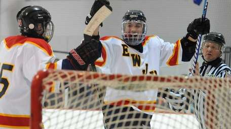 East Williston-Jericho Anthony Modica gets congratulated by teammate