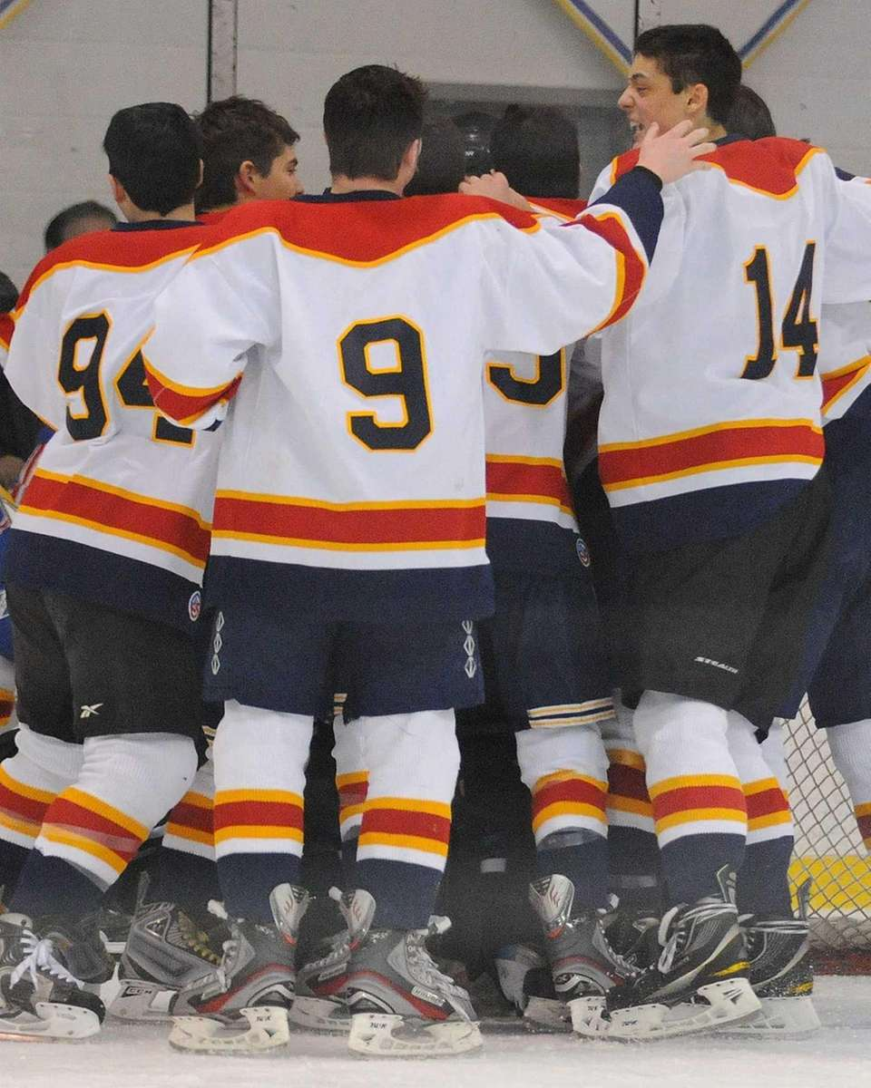 East Williston-Jericho teammates celebrate after their 5-3 win