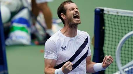 Andy Murray reacts after defeating Yoshihito Nishioka during