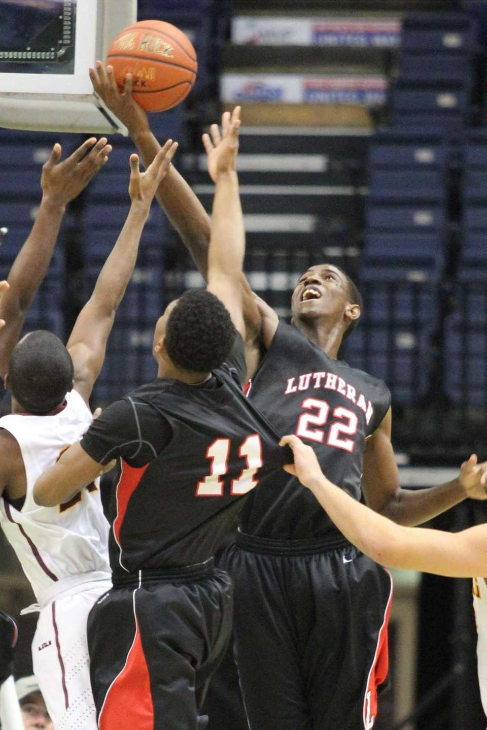 Long Island Lutheran's Kentan Facey goes high for
