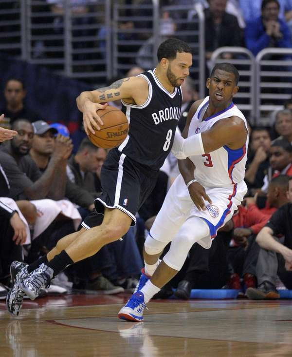 Nets guard Deron Williams, left, drives by Los
