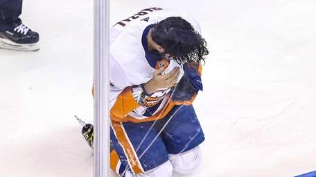 Mathew Barzal of the Islanders reacts after being