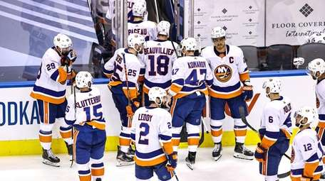 The Islanders react after their 4-3 overtime loss