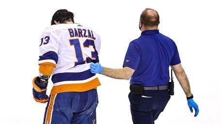 Mathew Barzal of the Islanders is helped off
