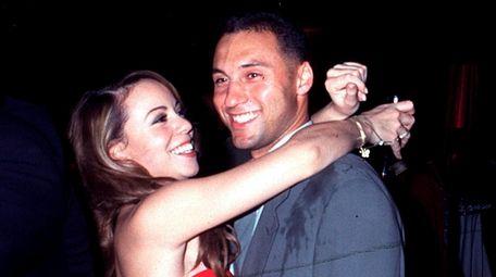 Mariah Carey and Derek Jeter hug at Sean