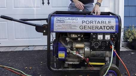 A gasoline-powered generator being used at an Oceanside
