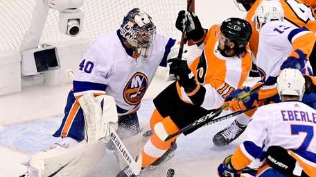 Islanders goaltender Semyon Varlamov makes a save as