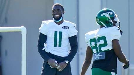 The Jets' Denzel Mims stand off to the