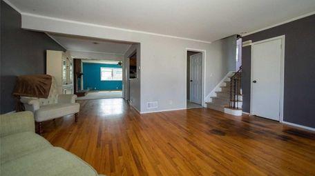 This three-bedroom, 1½-bathroom split-level house in Freeport, listed
