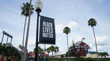 A Black Lives Matter banner is displayed outside
