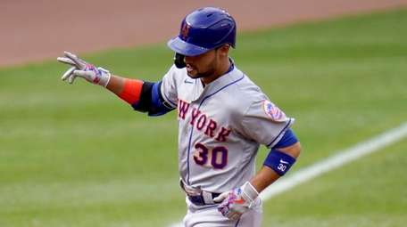 The Mets' Michael Conforto runs the bases after