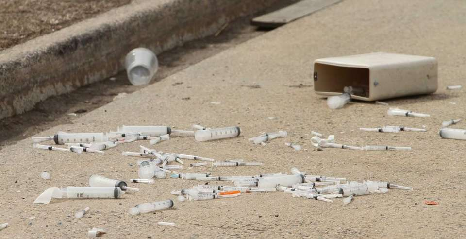 Dozens of used medical syringes were found by