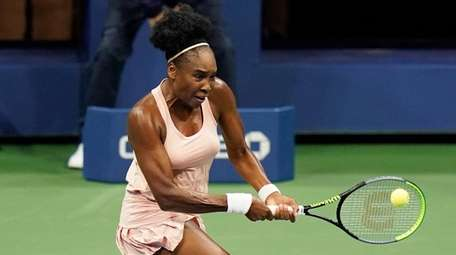 Venus Williams returns a shot to Karolina Muchova