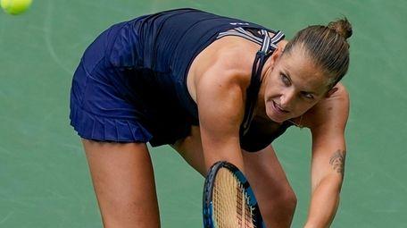 Karolina Pliskova returns a shot to Caroline Garcia