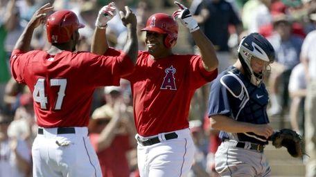 Los Angeles Angels outfielder Vernon Wells, center, celebrates