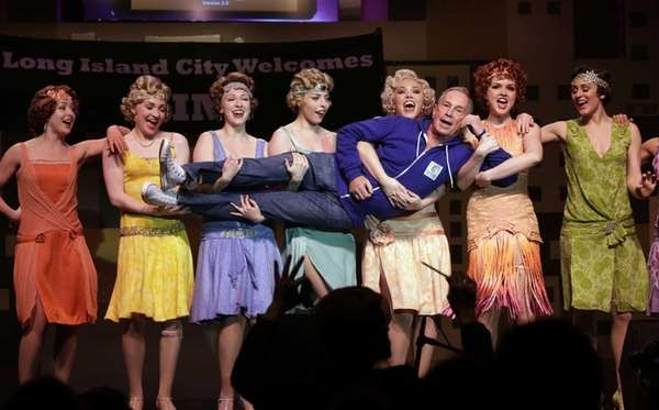 New York Mayor Michael Bloomberg performs with cast