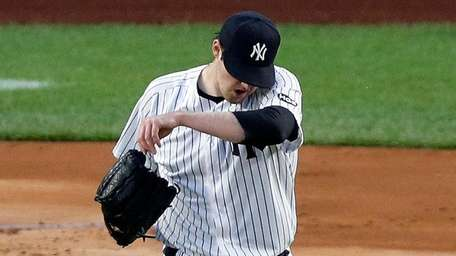 Jordan Montgomery of the Yankees reacts after surrendering