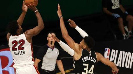 Jimmy Butler of the Miami Heat shoots the