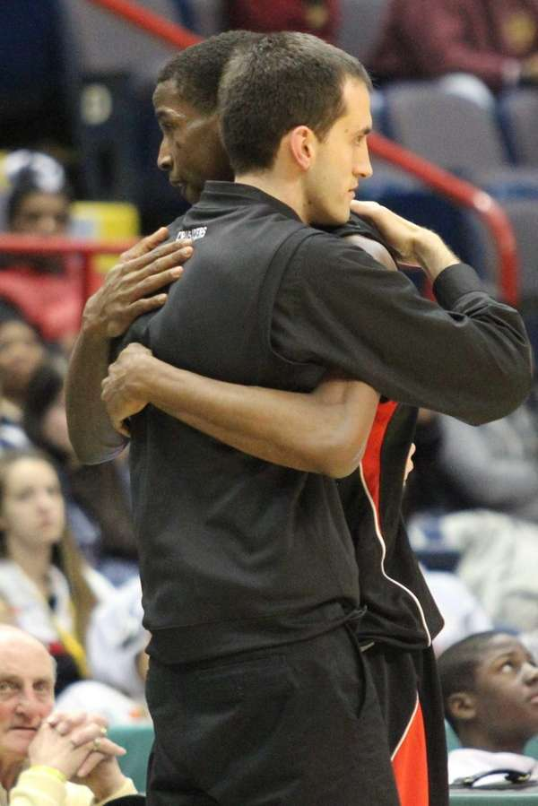 Long Island Lutheran's Kentan Facey hugs coach John