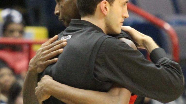 Long Island Lutheran's Kentan Facey hugs coach John