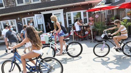 Bikers pass C.J's Fire Island in Ocean Beach