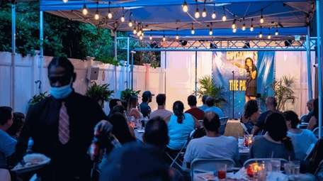 Comedian Olga Namer performs at the outdoor patio