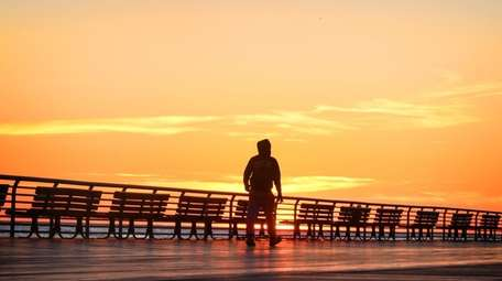 The iconic Long Beach boardwalk at sunset.