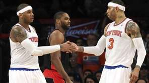 Carmelo Anthony and Kenyon Martin celebrate after Anthony