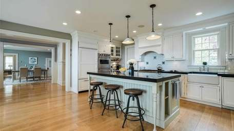 The house includes a gourmet kitchen, butler's pantry.