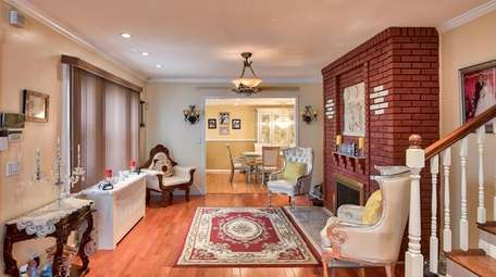 The house as cherry-stained hardwood floors, the agent