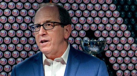 Islanders co-owner Jon Ledecky stands amongst Stanley Cups