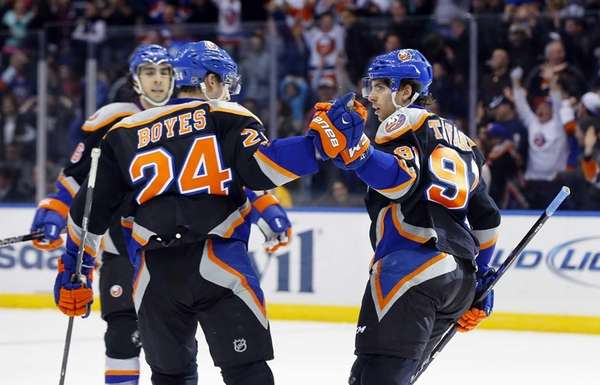 John Tavares celebrates his third-period goal with Brad