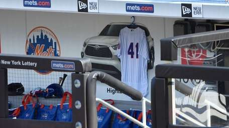 A Mets jersey with the number 41 hangs