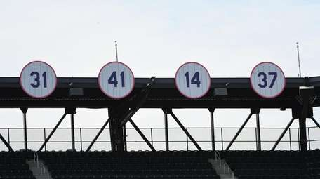 Mets legend Tom Seaver's #41 is seen over