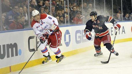 The Washington Capitals' Alex Ovechkin handles the puck