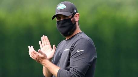 Jets head coach Adam Gase looks on at