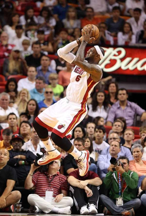 Miami Heat forward LeBron James shoots during a