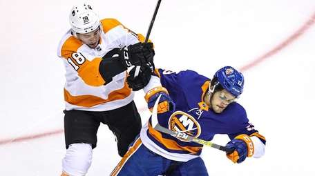 Tyler Pitlick of the Flyers checks Mathew Barzal