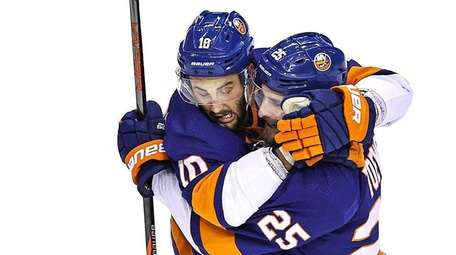 Derick Brassard of the Islanders is congratulated by